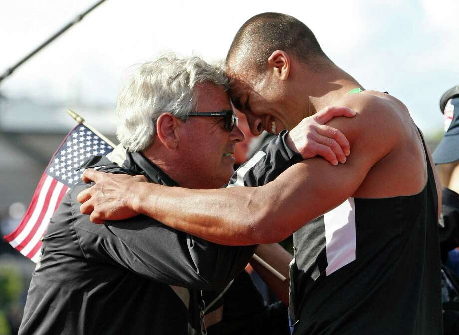 Ashton Eaton hugs his coach Harry Marra after breaking the world record in the men's decathlon after competing in the 1500 meter run portion during Day Two of the 2012 U.S. Olympic Track & Field Team Trials at Hayward Field on June 23, 2012 in Eugene, Oregon.  (Photo by Michael Heiman/Getty Images)  ORG XMIT: MER2016021716331368 Photo: Michael Heiman / 2012 Getty Images