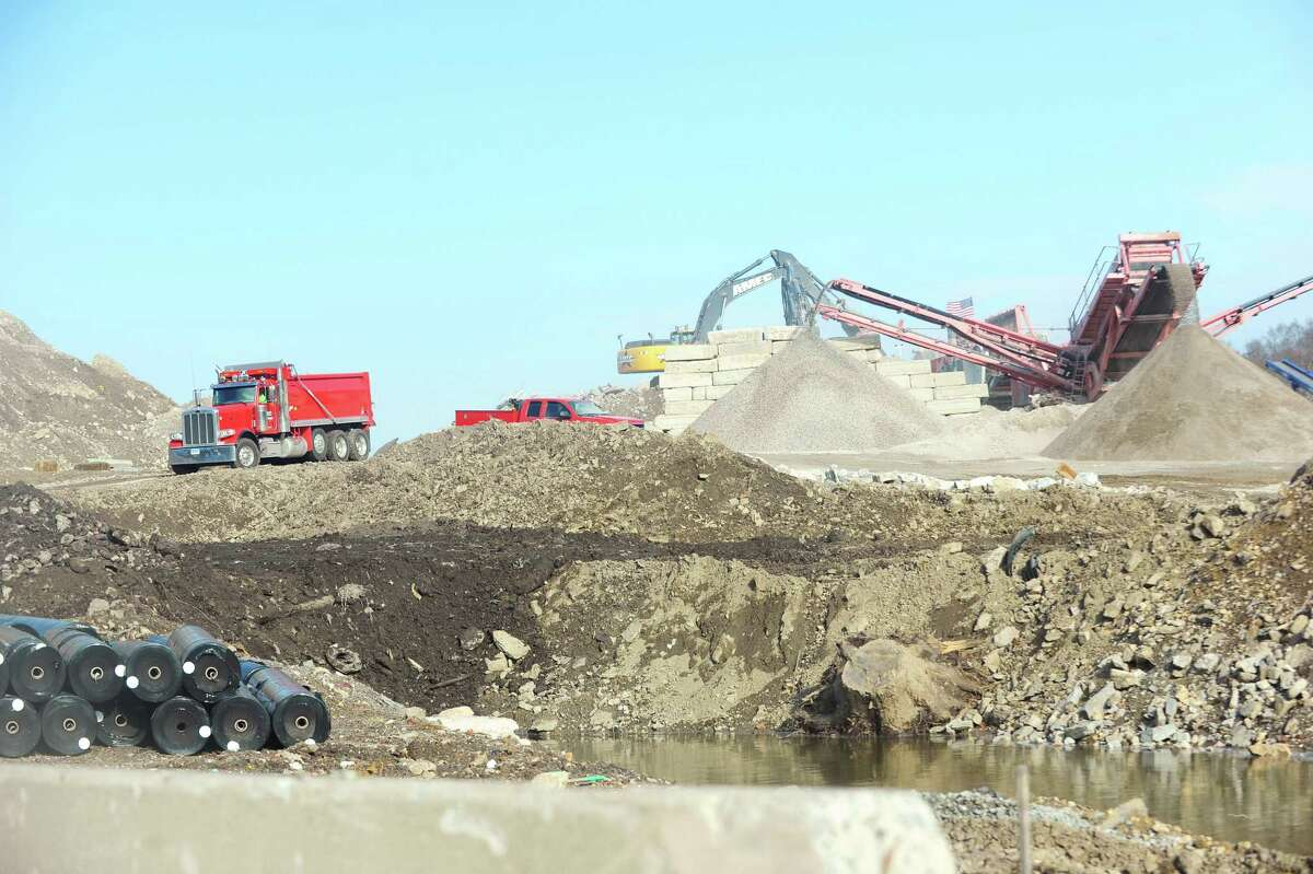 AMEC employees work on a 17-acre, city-owned site at Scofieldtown and Rockrimmon roads, where the city is rebuilding a park and recycling center. Neighbors have been watching the site, concerned about all the rock crushing that goes on at the project, which is six months overdue. Photographed on January 11, 2016.