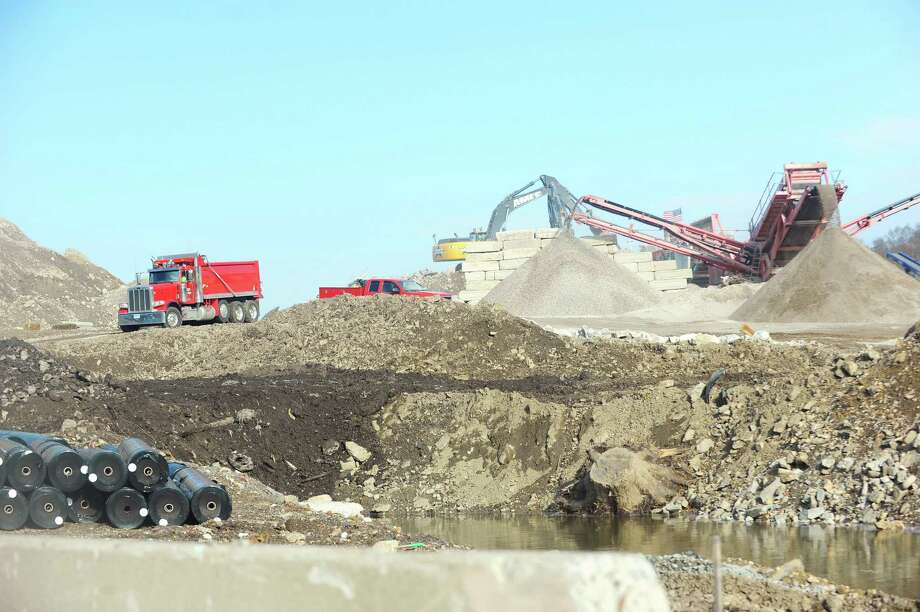 AMEC employees work on a 17-acre, city-owned site at Scofieldtown and Rockrimmon roads, where the city is rebuilding a park and recycling center. Neighbors have been watching the site, concerned about all the rock crushing that goes on at the project, which is six months overdue. Photographed on January 11, 2016. Photo: Michael Cummo / Hearst Connecticut Media / Stamford Advocate