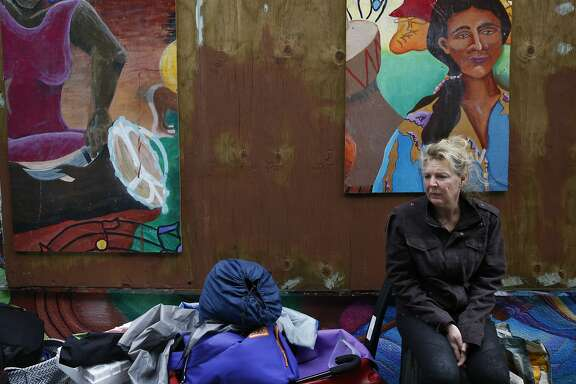 Kristin Vanscoy sits on her stuff while preparing to move after she and others who have been living along the sidewalk for months said that the police told them to move from their spot along Division Street Feb. 17, 2016 in San Francisco, Calif.