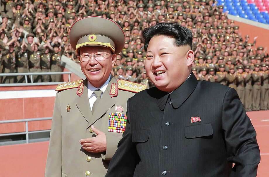 North Korean leader Kim Jong-Un, right, sharesa light moment with a soldier who participated in a military parade to celebrate the 70th anniversary of the Workers Party last year. While politicians and others focus on Isis, a reader says North Korea is more of a threat. Photo: KNS /AFP / Getty Images / AFP