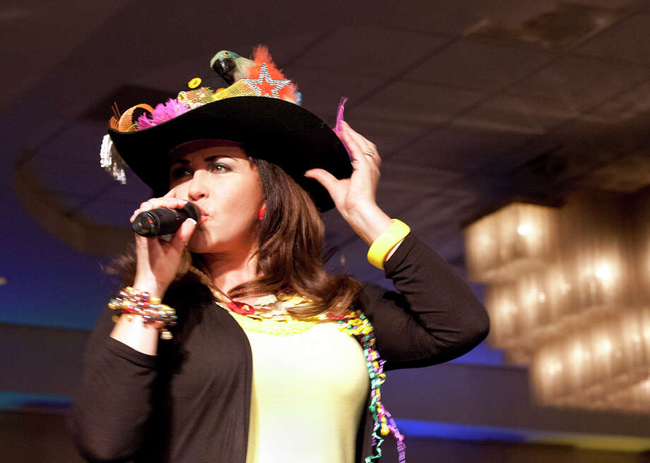 """Singer Patsy Torres performs in a hat decorated with a parrot and colorful feathers at the """"Got Hatitude?"""" Fiesta Hat Contest, Luncheon and Fashion Show at the Omni Hotel at the Colonnade in April 2013. Photo: File Photo / Special to the Express-News"""