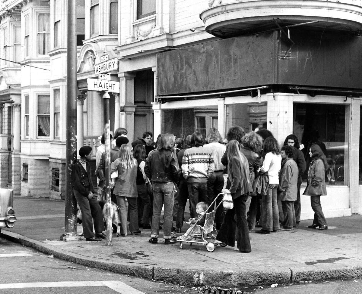 THEN A Haight & Ashbury meeting on the street corner is seen in this file photo from Oct. 29, 1973.