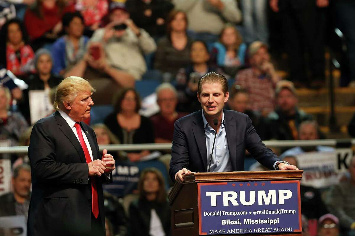 Republican presidential frontrunner Donald Trump (Left) speaks at an event with his son Eric Trump at the Mississippi Coast Coliseum on January 2, 2016 in Biloxi, Mississippi. Trump, who has strong support from Southern voters, spoke to thousands in the small Mississippi city on the Gulf of Mexico. Trump continues to split the GOP establishment with his populist and controversial views on immigration, muslims and some of his recent comments on women.