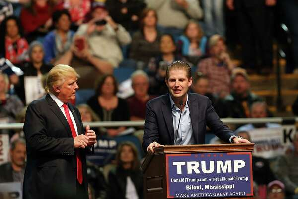 BILOXI, MS - JANUARY 02: Republican presidential frontrunner Donald Trump (Left) speaks at an event with his son Eric Trump at the Mississippi Coast Coliseum on January 2, 2016 in Biloxi, Mississippi. Trump, who has strong support from Southern voters, spoke to thousands in the small Mississippi city on the Gulf of Mexico. Trump continues to split the GOP establishment with his populist and controversial views on immigration, muslims and some of his recent comments on women.