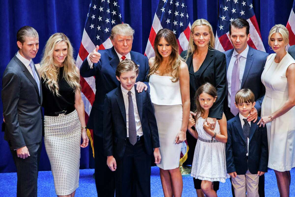 (L-R) Eric Trump, Lara Yunaska Trump, Donald Trump, Barron Trump, Melania Trump, Vanessa Haydon Trump, Kai Madison Trump, Donald Trump Jr., Donald John Trump III, and Ivanka Trump pose for photos on stage after Donald Trump announced his candidacy for the U.S. presidency at Trump Tower on June 16, 2015 in New York City. Trump is the 12th Republican who has announced running for the White House.