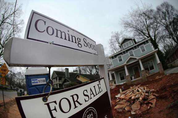 "In this Tuesday, Jan. 26, 2016, photo, a ""For Sale"" sign hangs in front of a home under construction in Atlanta. On Wednesday, Feb. 17, 2016, the Commerce Department reports on U.S. home construction in January. (AP Photo/John Bazemore)"