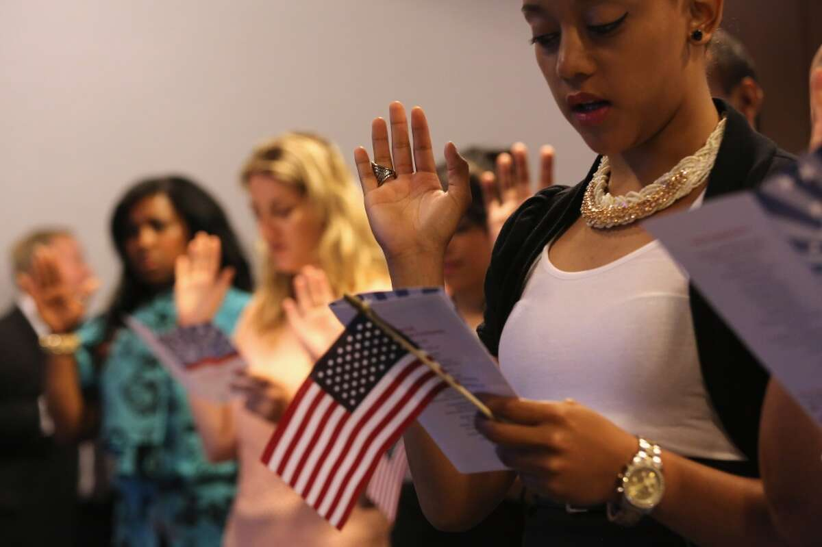 NEW YORK, NY - JULY 09: Immigrants take the oath of allegiance to the United States during a naturalization ceremony on July 9, 2014 in New York City. Seventy-five people became American citizens at a event held by U.S. Citizenship and Immigration Services (USCIS), at the League of United Latin American Citizens (LULAC), convention in midtown Manhattan. (Photo by John Moore/Getty Images)
