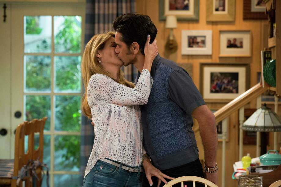 John Stamos and Lori Loughlin return as spouses Jesse and Becky who famously can't keep their hands off each other in 'Fuller House,'  the Netflix reboot of 'Full House.' February, 2016 Fuller House Photo: Michael Yarish/Netflix / Netflix