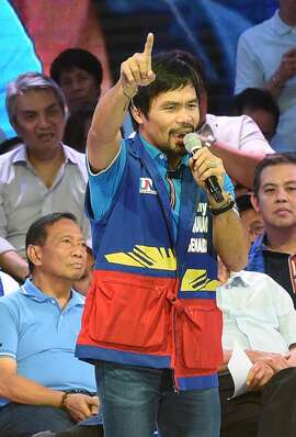 Senatorial candidate of the opposition party and boxing icon Manny Pacquiao speaks during their proclamation rally in Manila on February 9, 2016. A cliffhanger race to lead the Philippines began February 9 with emotion-charged rallies by a dead movie star's adopted daughter, a politician who brags about killing criminals and other top contenders.  AFP PHOTO / TED ALJIBETED ALJIBE/AFP/Getty Images