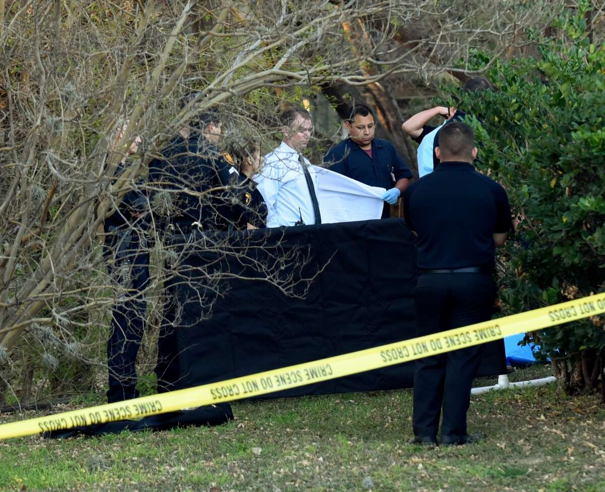 Police look over the scene in the 700 block of Isom where the body of a woman was found on Wednesday, Feb. 17, 2016. The woman had multiple stab wounds.