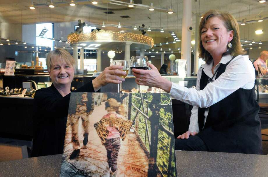 "Patricia Carley and Debbie Fowler at Glennpeter Jewelers on Friday Feb. 5, 2016 in Albany, N.Y., where they will be holding a fundraiser on Feb. 26 for their new nonprofit, Eyes Wide Open NENY Inc. Artist Deborah Hickey donated her ""Owl Princess"" photo transfer for the silent auction. (Michael P. Farrell/Times Union) Photo: Michael P. Farrell / 10035218A"