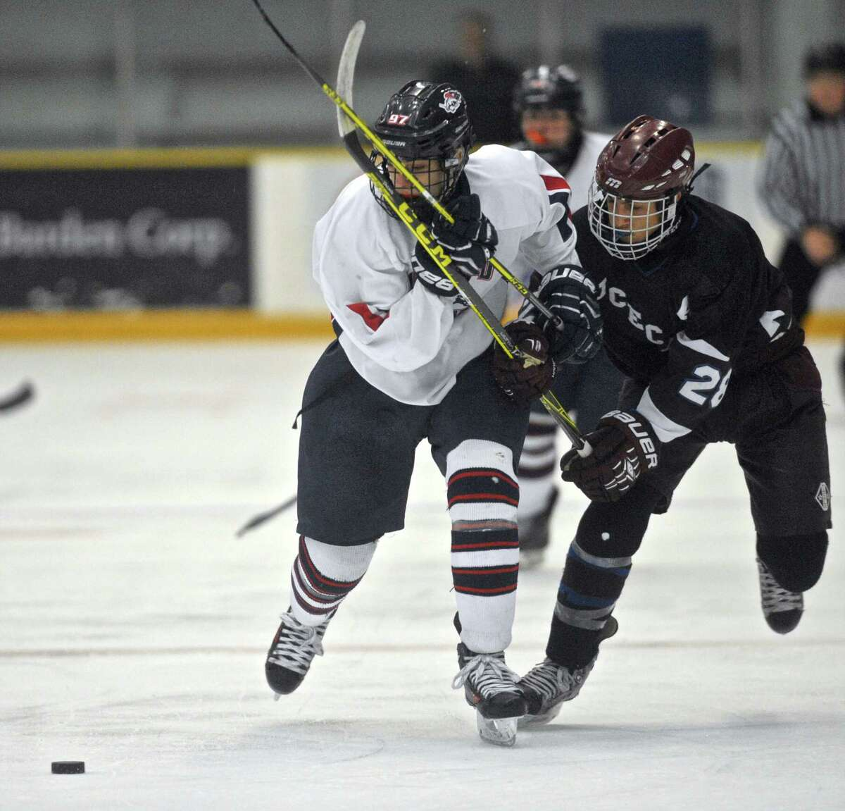 NFI's Sam Mitchell (97) and BBD's Andrew Almeida (28) battle for the puck in the boys high school ice hockey game between Brookfield-Bethel-Danbury and New Fairfield-Immaculate on Wednesday, February 17, 2016, at the Danbury Ice Arena, in Danbury, Conn.
