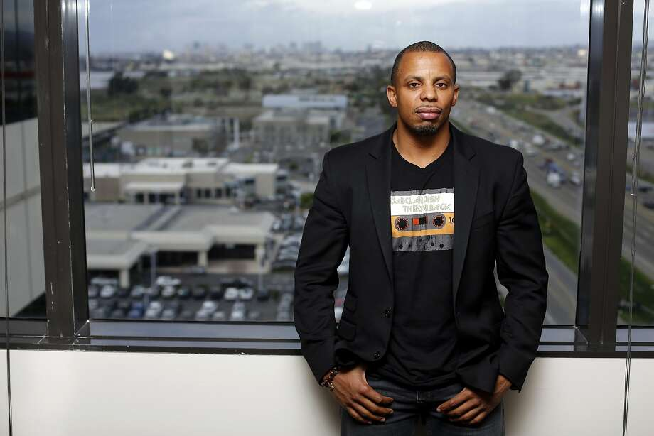 Ephraim Walker stands in the law offices of John Burris with downtown Oakland in the background in Oakland, California, on Wednesday, Feb. 17, 2016. Photo: Connor Radnovich, The Chronicle