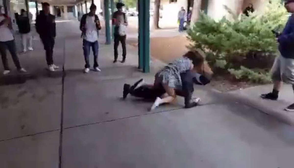 Video: Girl knees boy in the face in school fight