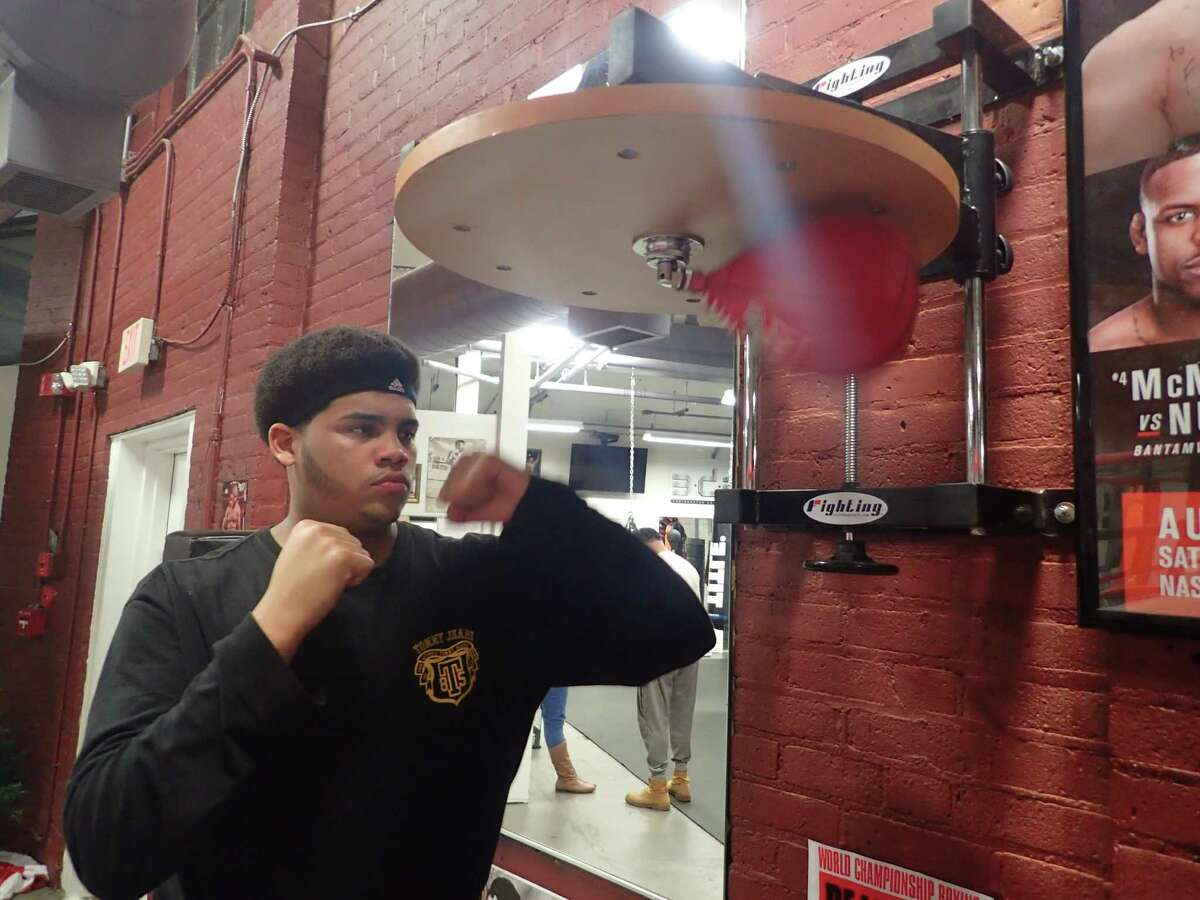 FILE PHOTO: Fernely Feliz Jr. hits the speed bag during a recent training session at Champs Boxing Club in Danbury.