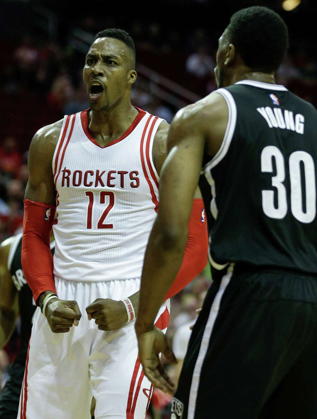 Houston Rockets center Dwight Howard (12) reacts after scoring on Brooklyn Nets forward Thaddeus Young (30) during the first half of an NBA basketball game at Toyota Center Wednesday, Nov. 11, 2015, in Houston. ( Brett Coomer / Houston Chronicle )