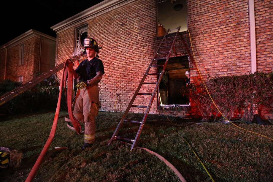 A two-alarm broke out at an apartment complex in the 6200 block of Renwick on Wednesday night. Photo: Jon Shapley, Chronicle