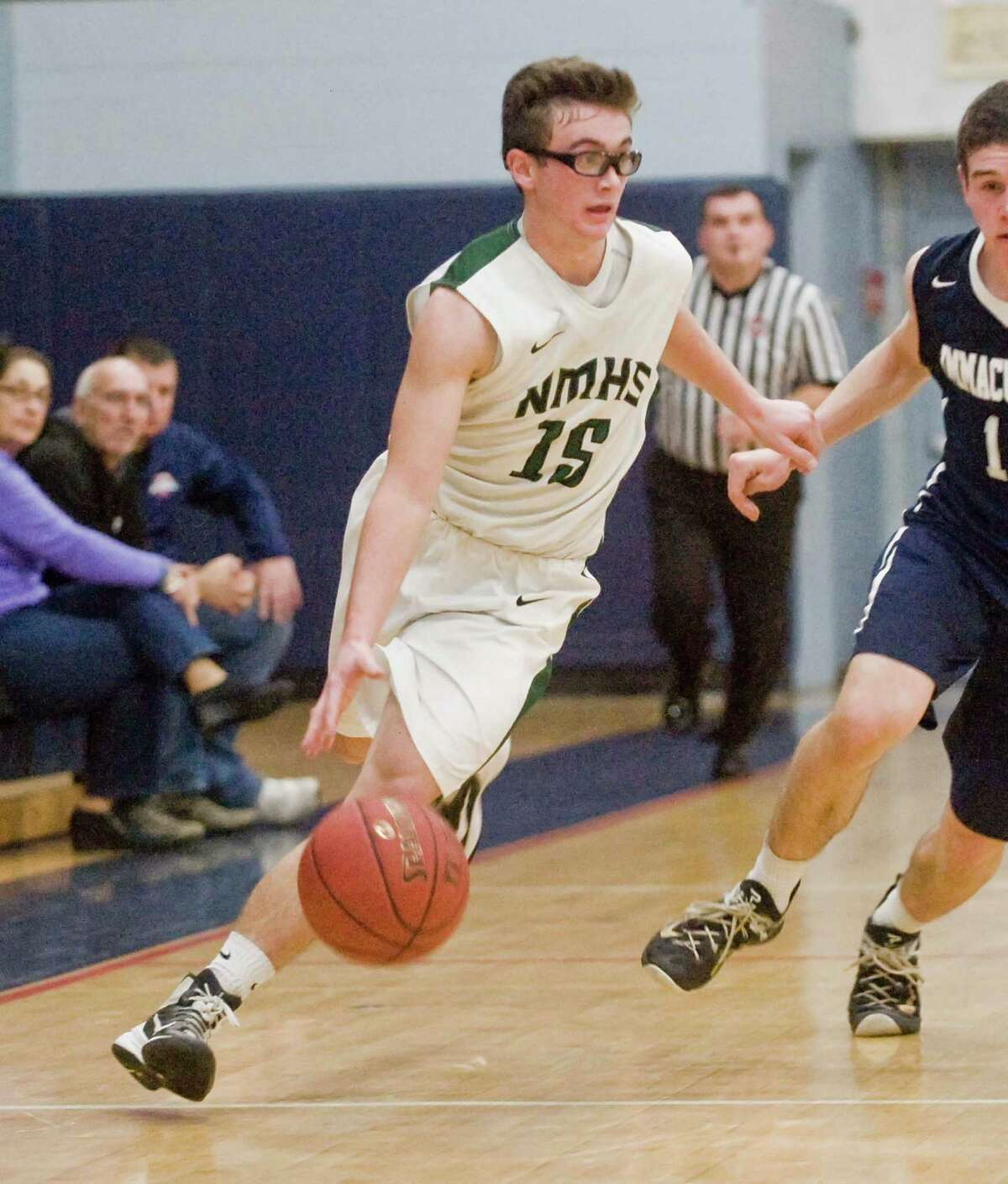 FILE PHOTO: New Milford High School's Max Vaughey brings the ball up the court in the Candlewood Classic boys basketball tournament against Immaculate High School, played at New Fairfield High School. Saturday, Dec. 26, 2015