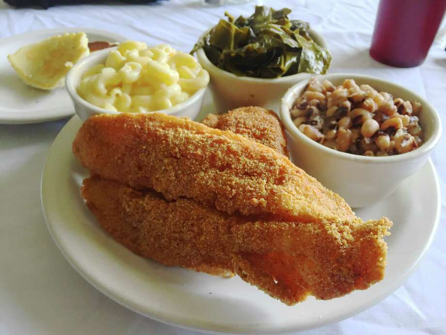 Fried fish fillets with macaroni and cheese, collard greens and black-eyed peas at Southern Girls, 6060 Montgomery Dr, Photo: Edmund Tijerina / San Antonio Express-News