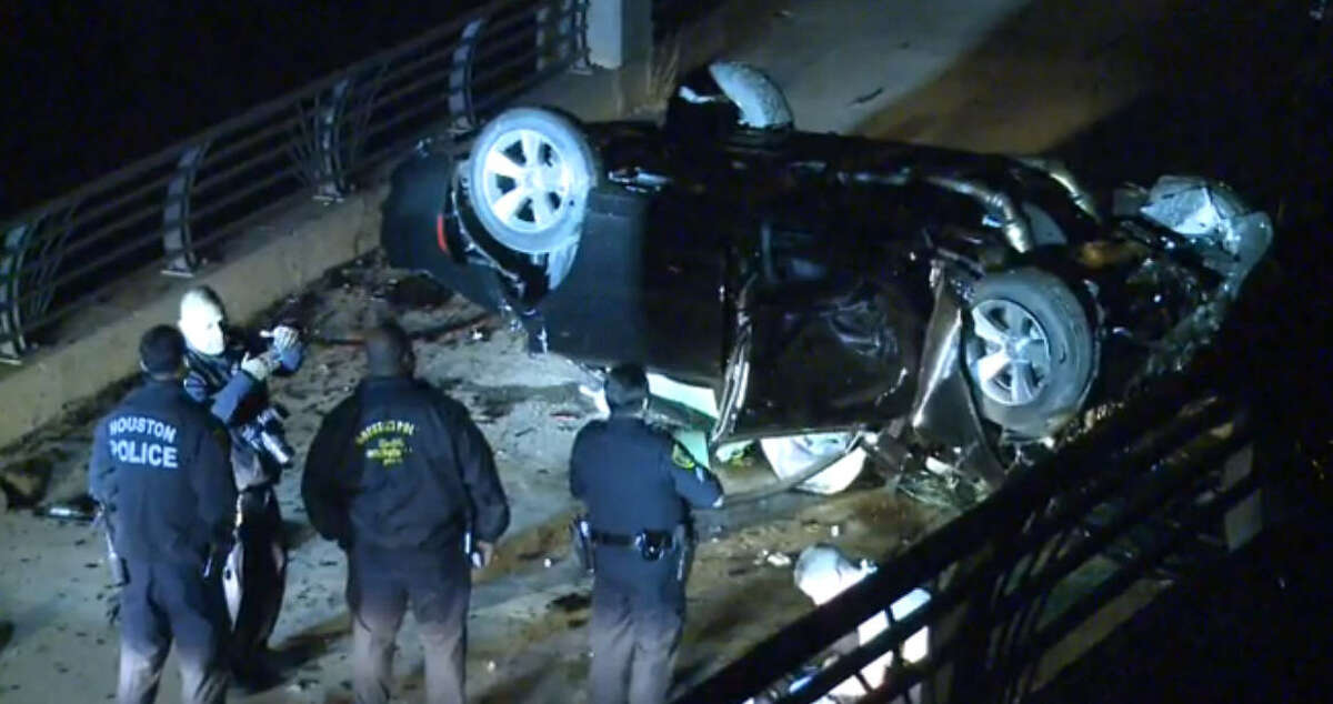 A fatal crash occurred Thursday morning when a car veered from Highway 288 in south Houston and landed upside down on the biking/hiding trail below along Brays Bayou, said Sgt. James Roque of the Houston Police Department. Feb. 18, 2016
