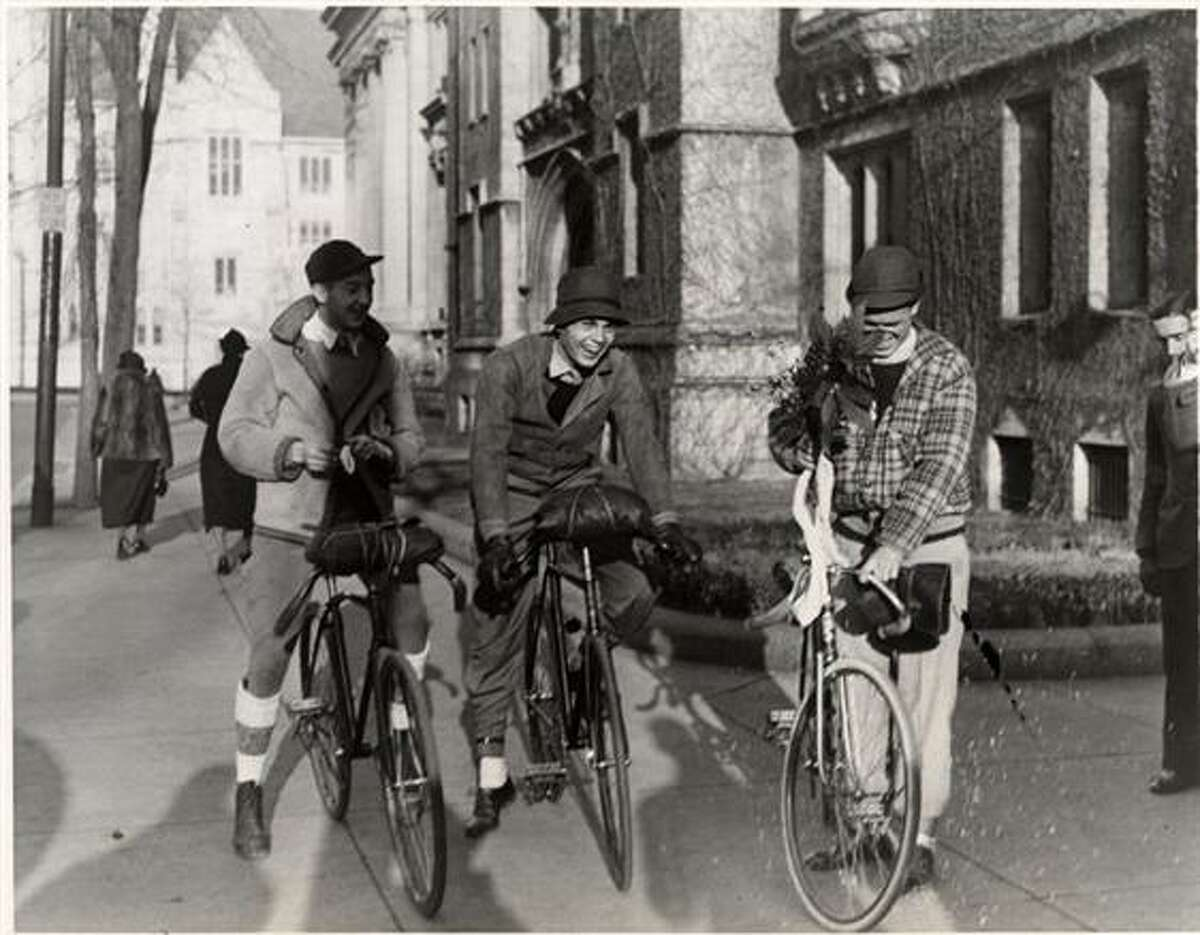 Three students bicycling.