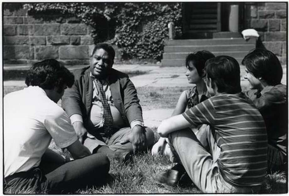 Students and professor holding a class outside. Photo: Photographs Used In The Publication Of The Yale Alumni Magazine, Ca. 1917-1973. Manuscripts & Archives, Yale University