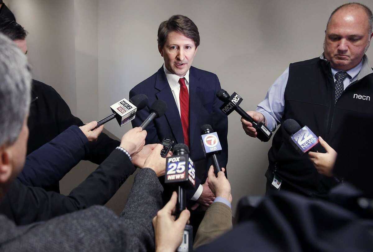 Chairman of the Fantasy Sports Trade Association Peter Schoenke speaks with reporters following a public hearing in Boston, Tuesday, Jan. 12, 2016. Schoenke objected to regulations proposed by Massachusetts Democratic Attorney General Maura Healey for online sites including DraftKings and FanDuel. (AP Photo/Michael Dwyer)