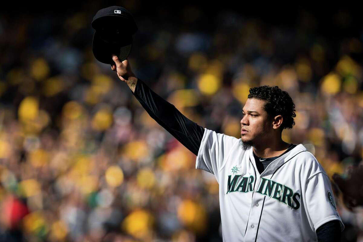 SEATTLE -- Pitcher Felix Hernandez raises his cap to thousands of fans after being relieved from the mound during the final Mariners game of the 2014 regular season game at Safeco Field.