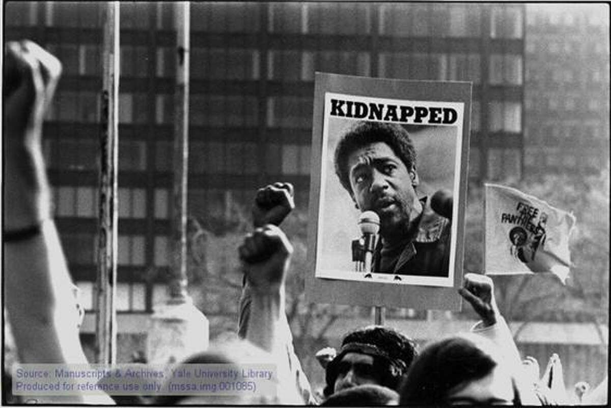 """KIDNAPPED"""" sign with a picture of Black Panther member Bobby Seale."""