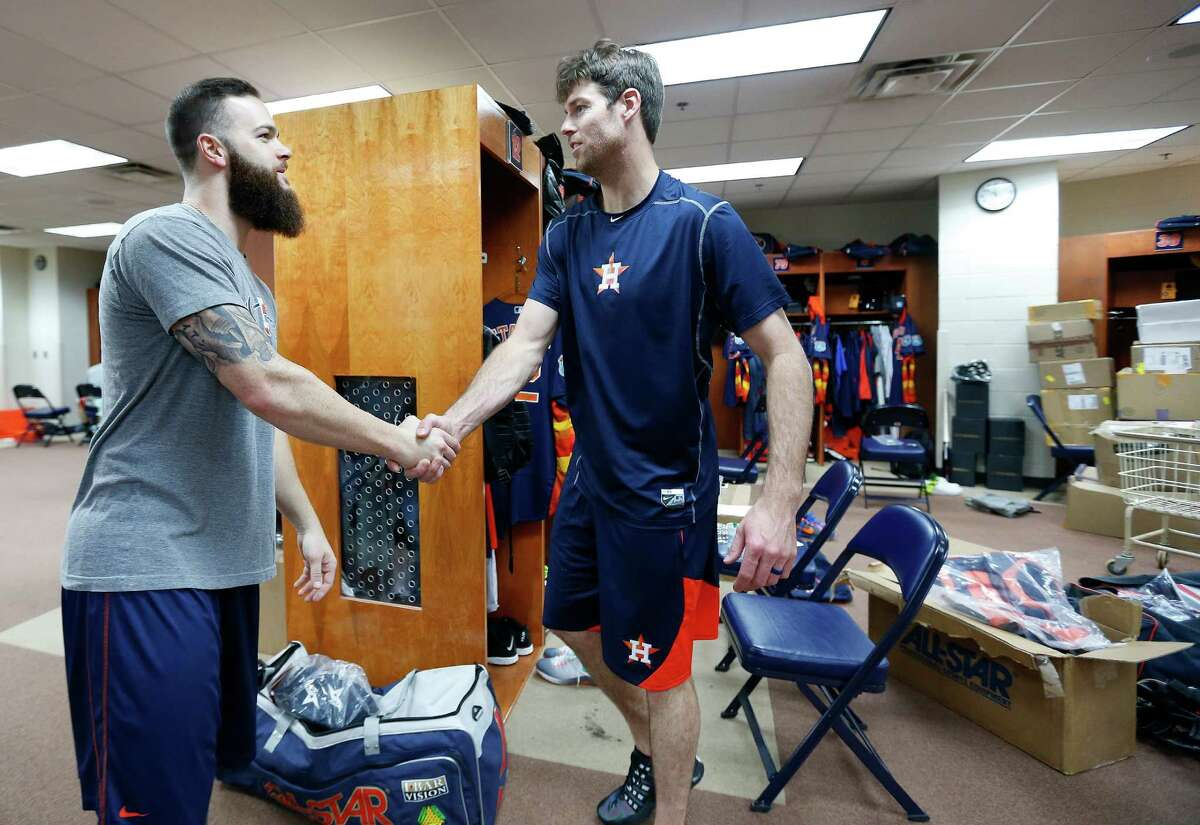 Houston Astros ace Dallas Keuchel (left) meets new teammate Doug Fister in the clubhouse during report day for pitchers and catchers at their Osceola County facility, in Kissmmee, Fla., on Thursday, Feb. 18, 2016.