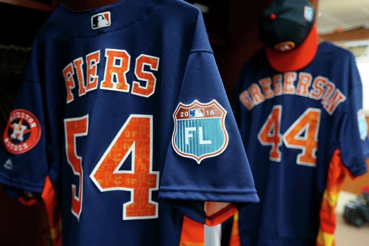 Houston Astros Mike Fiers' and Houston Astros Luke Gregerson's spring training jersey hang in their lockers during report day for Houston Astros pitchers and catchers at their Osceola County facility, in Kissmmee, FL, Thursday, Feb. 18, 2016.