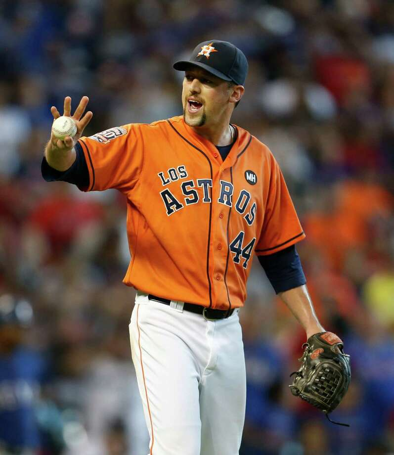 Houston Astros relief pitcher Luke Gregerson (44) signals as manager A.J. Hinch came out of the dugout during the ninth inning of an MLB game at Minute Maid Park on Saturday, Sept. 26, 2015. ( Karen Warren / Houston Chronicle ) Photo: Karen Warren, Staff / © 2015 Houston Chronicle