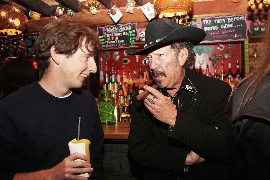 "Kinky Friedman speaks to a young voter (Hudson Hansard) while Kevin Russell and the ""Shinyribs"" performed at Under the Volcano in 2016. Photo: Pin Lim, Freelance / Copyright Pin Lim."