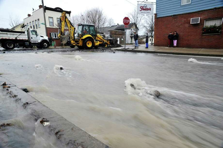 Water rushes down 124th St. which was flooded following a water main break in the area of 125th Street and 5th Ave. on Sunday morning, Jan. 17, 2016, in Troy, N.Y.  (Paul Buckowski / Times Union)