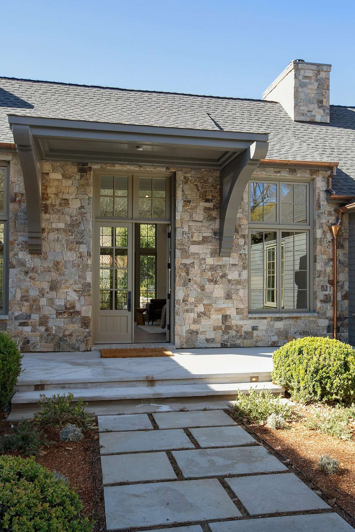 A series of concrete pavers leads to the home's stately, yet inviting, entryway.