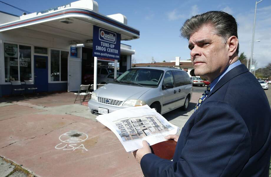 Gordon Galvan studies renderings of residential property he hopes to develop at the site in San Leandro. Photo: Paul Chinn, The Chronicle