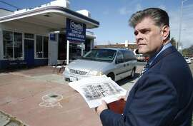 Gordon Galvan studies renderings of residential property he hopes to develop at the site in San Leandro, Calif. on Thursday, Feb. 18, 2016. Galvan owns of the land where his family operated a Texaco station and where he pumped gas a teenager. San Leandro is experiencing a building boom with two large projects nearing completion near the BART station and another project working its way through the planning process.