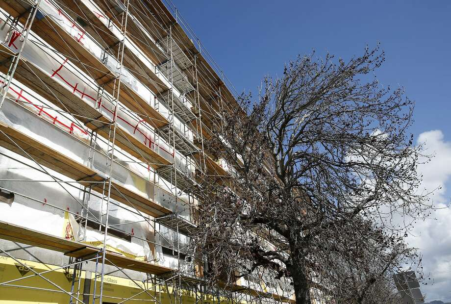Construction continues on the 115-unit Marea Alta residential development across the street from the BART station in San Leandro. Photo: Paul Chinn, The Chronicle