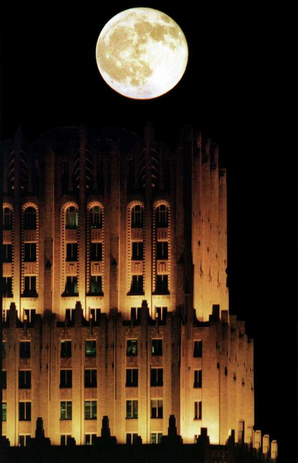 The 35-story Chase Bank Building, completed in 1929 as the Gulf Building, seems awash in lunar light July 28, a full-moon night. Photo: Kevin Fujii, Staff / Houston Chronicle