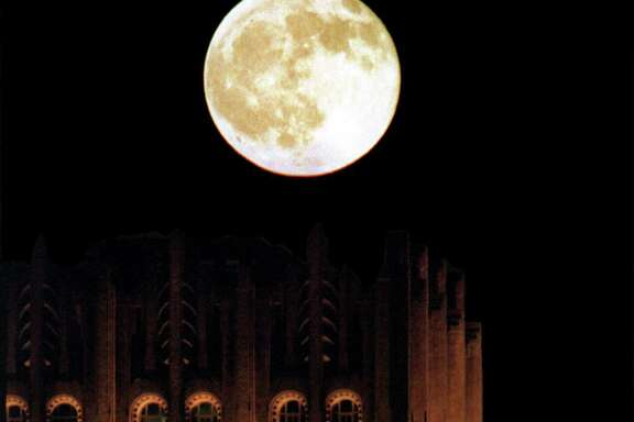 The 35-story Chase Bank Building, completed in 1929 as the Gulf Building, seems awash in lunar light July 28, a full-moon night.