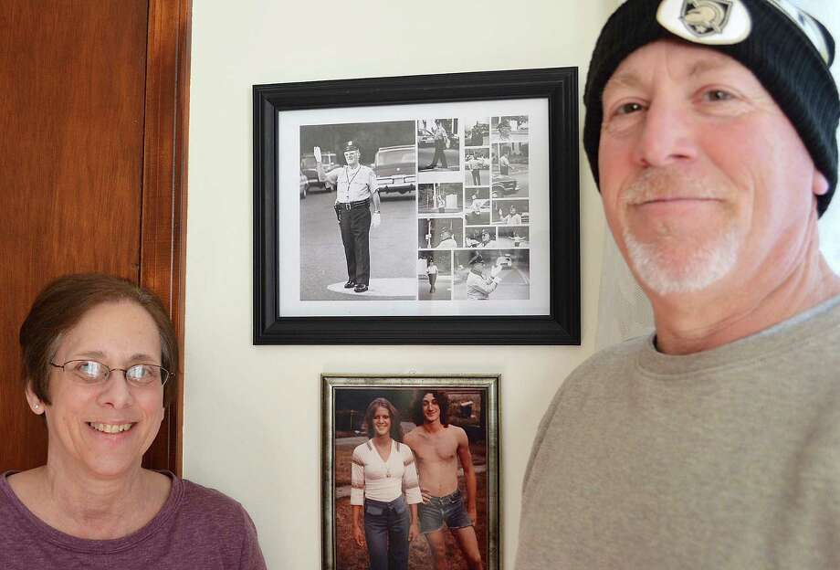 Sharon Cribari Saccary and her brother Ed Cribari flank a photo collage of their father, the late William F. Cribari Sr., and below, of their late brother and sister, Tucker and Sandy. Photo: Jarret Liotta /For Hearst Connecticut Media / Westport News