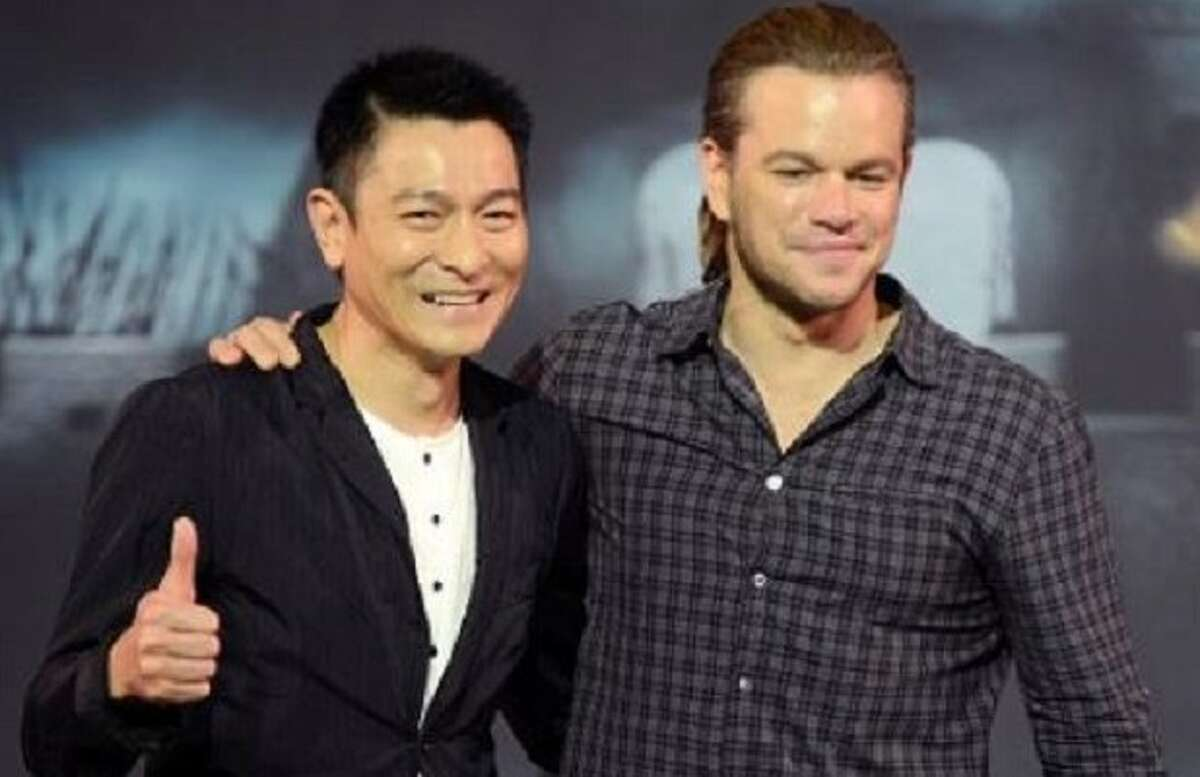 """Actor Matt Damon, right, speaks next to Hong Kong movie star Andy Lau during a press conference of their latest movie """"The Great Wall"""" held at a hotel in Beijing, China, Thursday, July 2, 2015."""