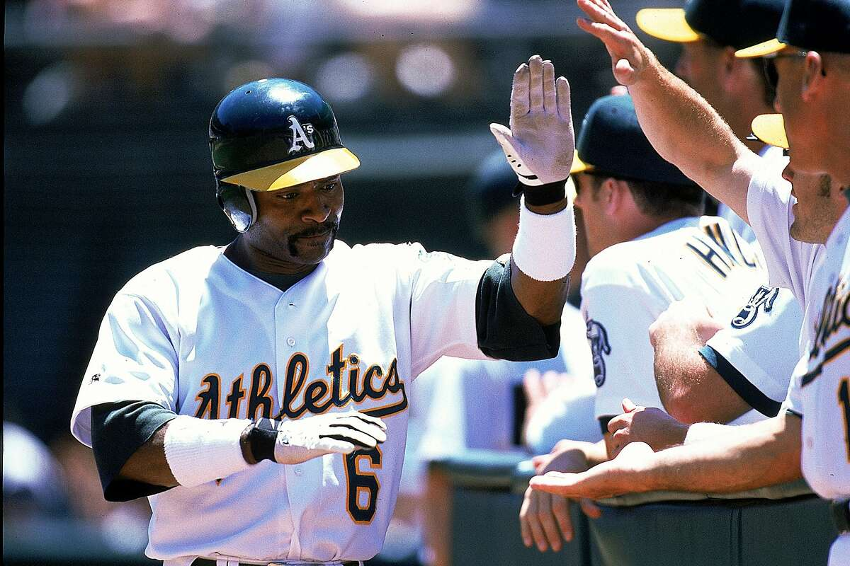 Tony Phillips of the Oakland Athletics high fives teammates during the game against the Texas Rangers at the Network Coliseum in Oakland, California.