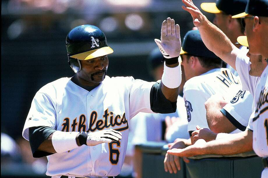Tony Phillips of the Oakland Athletics high fives teammates during the game against the Texas Rangers at the Network Coliseum in Oakland, California.  Photo: Jed Jacobsohn, Getty Images