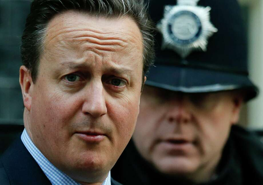 Britain's Prime Minister, David Cameron, leaves 10 Downing Street in London, Thursday, Feb. 18, 2016. Cameron is due to attend on Thursday a crucial EU summit in Brussels.  (AP Photo/Alastair Grant) Photo: Alastair Grant, STF / AP