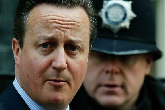 Britain's Prime Minister, David Cameron, leaves 10 Downing Street in London, Thursday, Feb. 18, 2016. Cameron is due to attend on Thursday a crucial EU summit in Brussels.  (AP Photo/Alastair Grant)