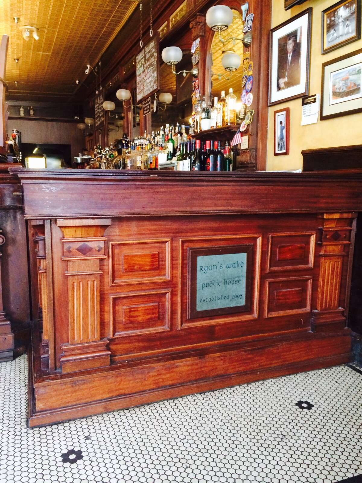 Peter Albrecht, of Troy, a master carpenter and raconteur who died Wednesday at 62, built this section of the bar at Ryan's Wake in Troy, as well as several other bars and wooden bar elements at pubs across the city. (Photo courtesy of Chris Ryan)