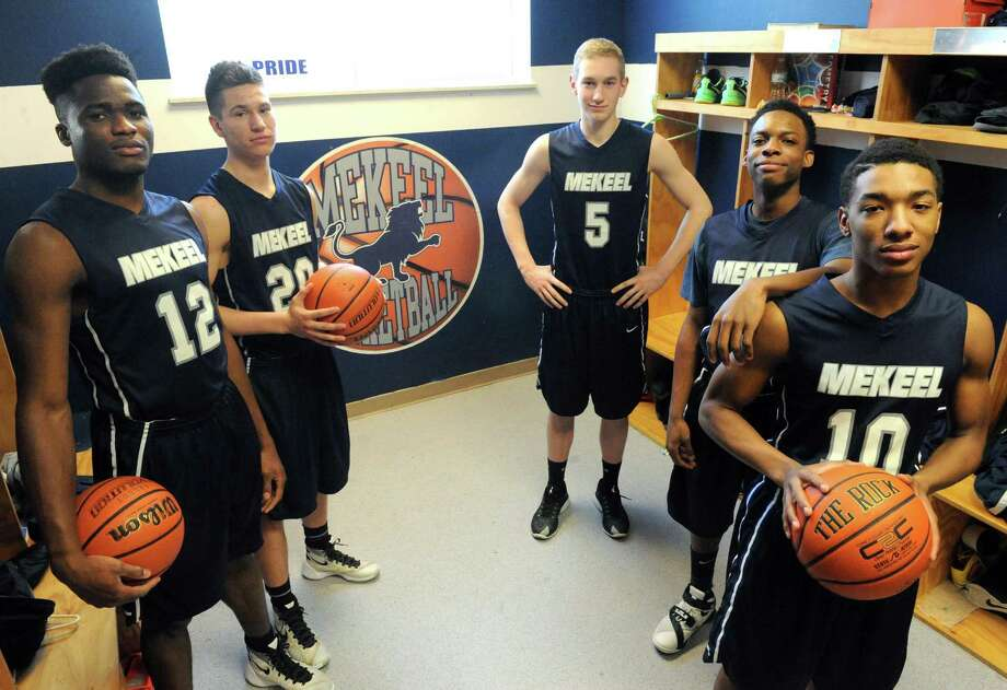 The Mekeel Christian boys' basketball team's starting five, left to right, Oscar Heji, Scott Voelker, Carter Stewart, Deonte Holder and Kevin Braye on Thursday Feb. 18, 2016 in Scotia, N.Y. New York .(Michael P. Farrell/Times Union) Photo: Michael P. Farrell / 10035491A