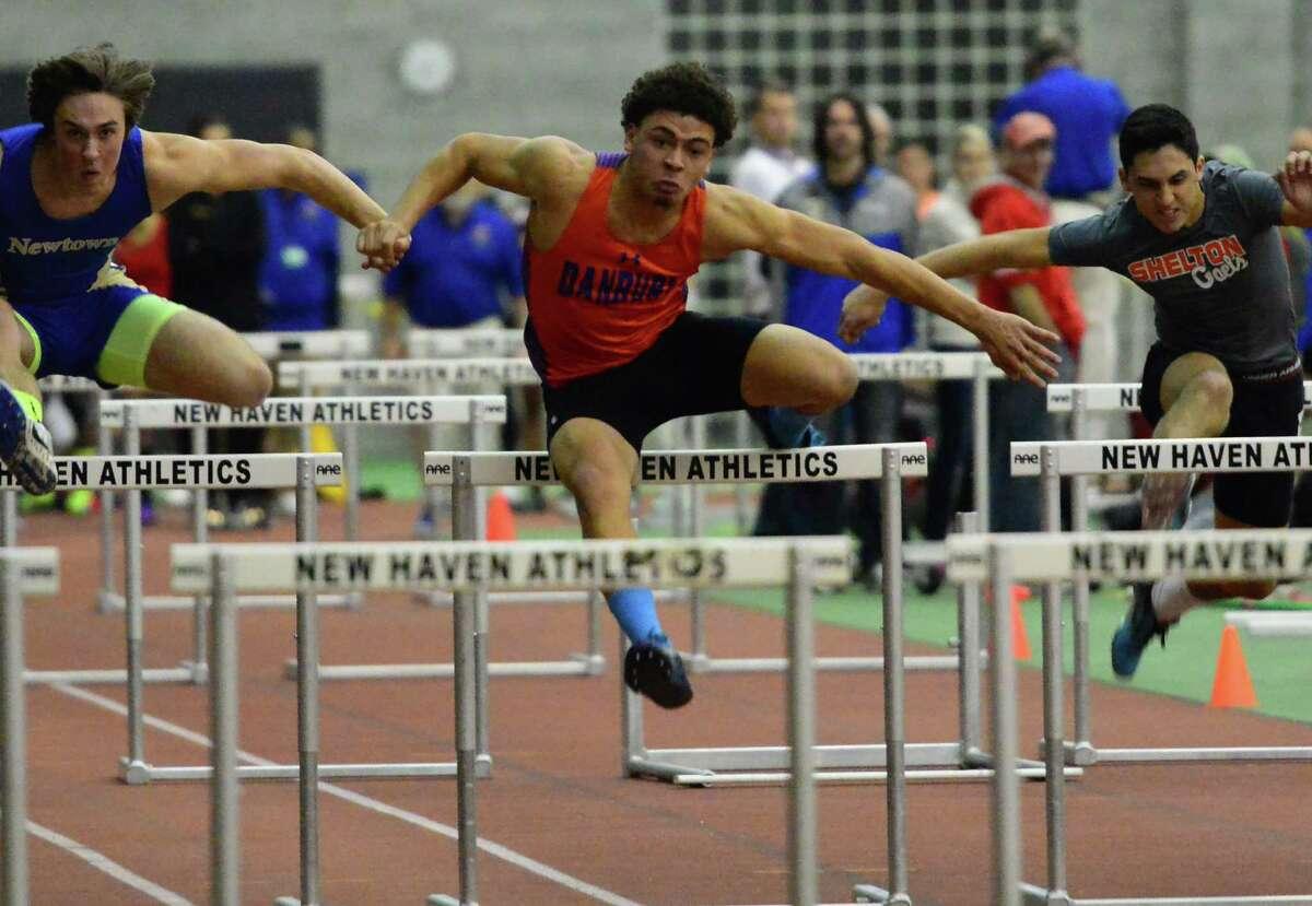 Danbury's Chase Nalley competes in the 55 hurdles during the Class LL championships in New Haven on Jan. 11, 2013.